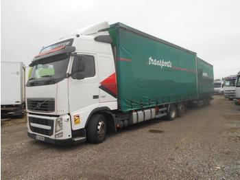 Camion bâche Volvo FH12 460