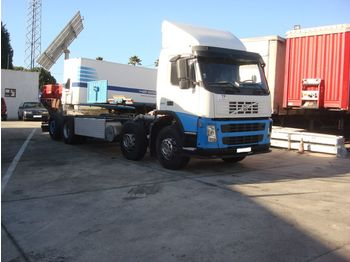 VOLVO FM 380 left hand drive 8X2 - camion plateau ridelle
